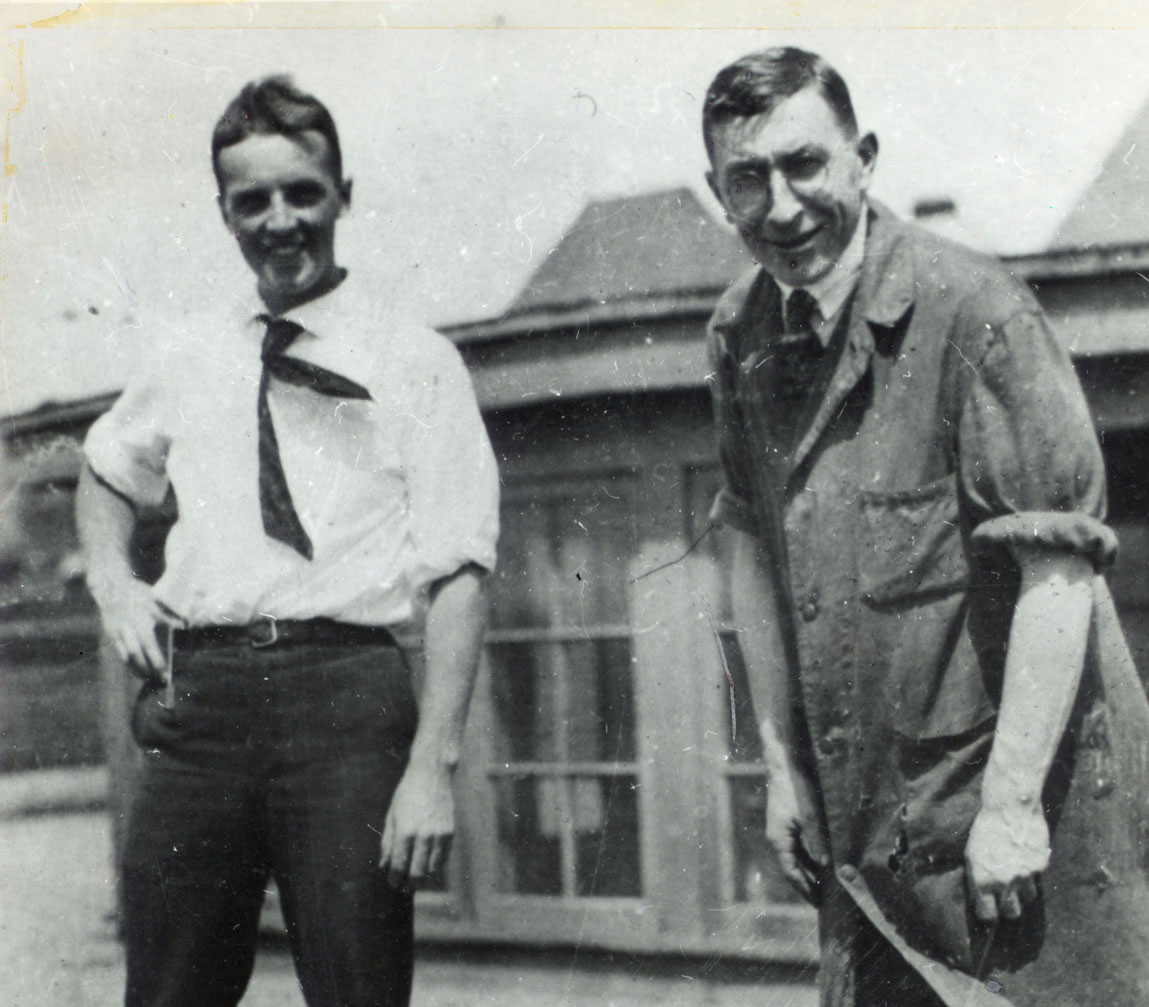 Frederick Banting, Charles Best and a dog standing on the roof of the Medical Building at the University of Toronto.
