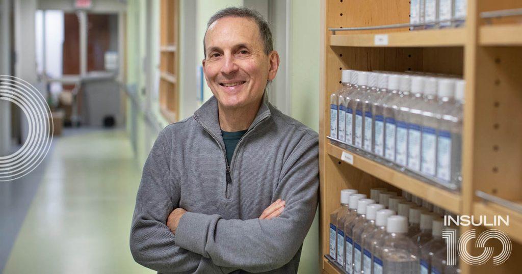 Daniel Drucker stands in a research building
